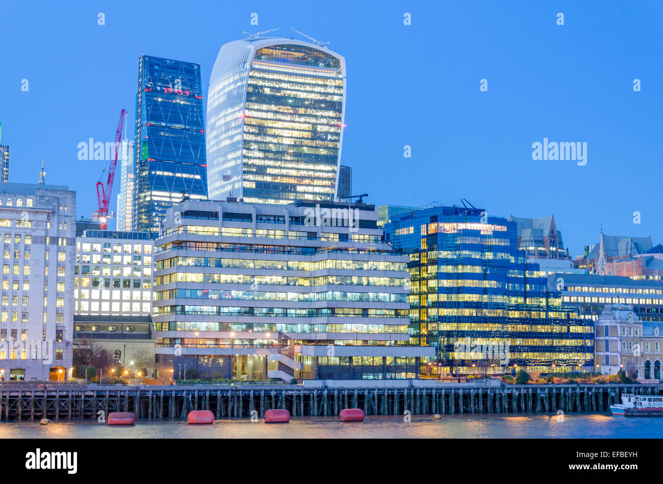 London skyline at night with the Cheesegrater and Walkie-Talkie buildings in view - Stock Image