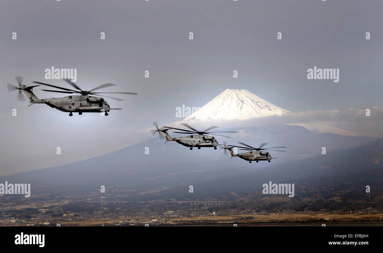 Three US Marine CH-53E Super Stallion helicopters fly past Mount Fuji January 24, 2015 in Shizuoka, Japan. - Stock Image