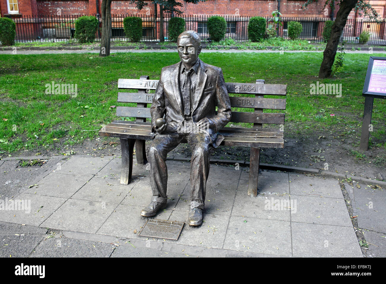 Statue of Alan Turing on a seat, in Sackville Gardens, Manchester. - Stock Image