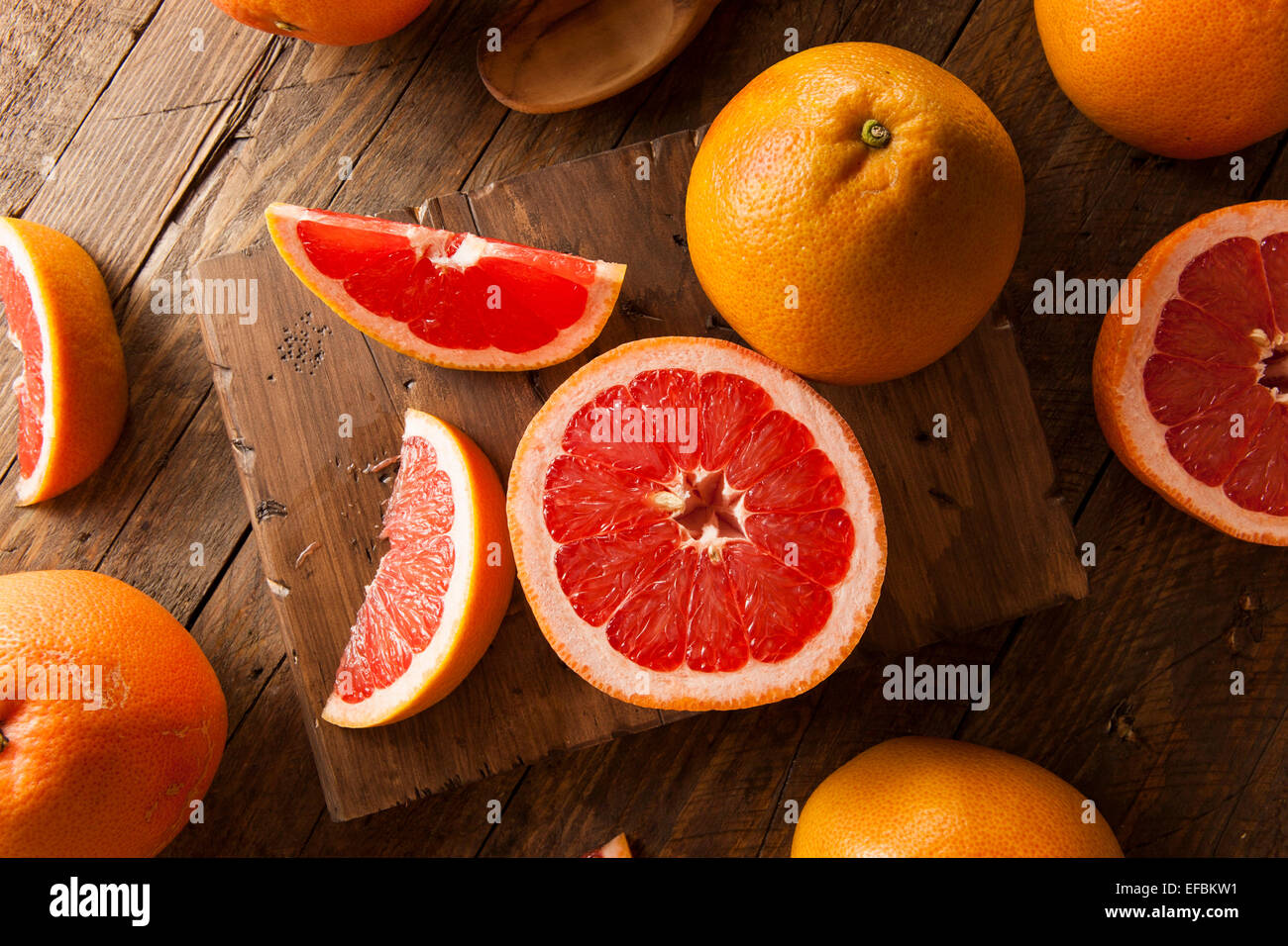 Healthy Organic Red Ruby Grapefruit on a Background - Stock Image
