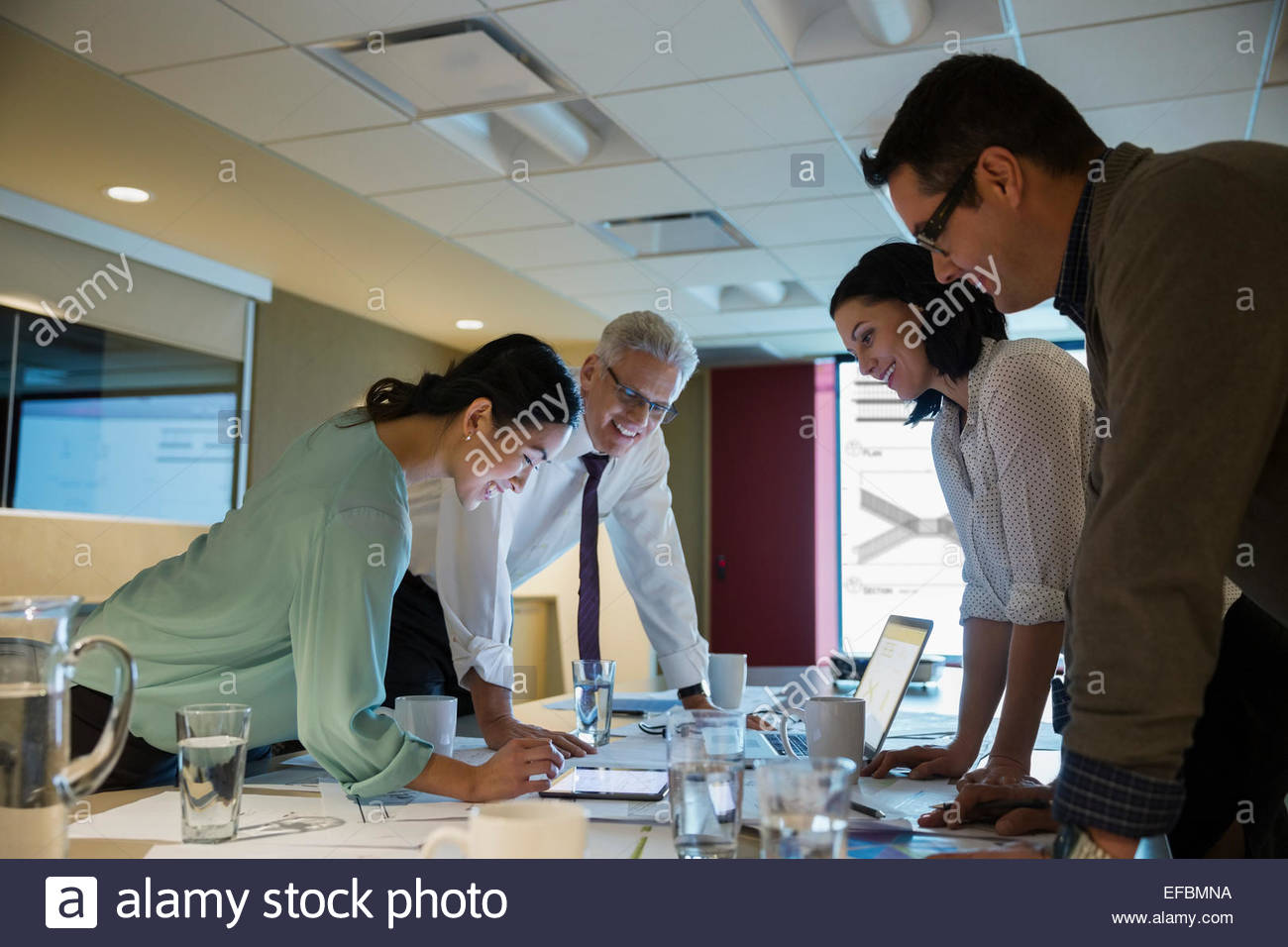 Business people meeting late in conference room - Stock Image