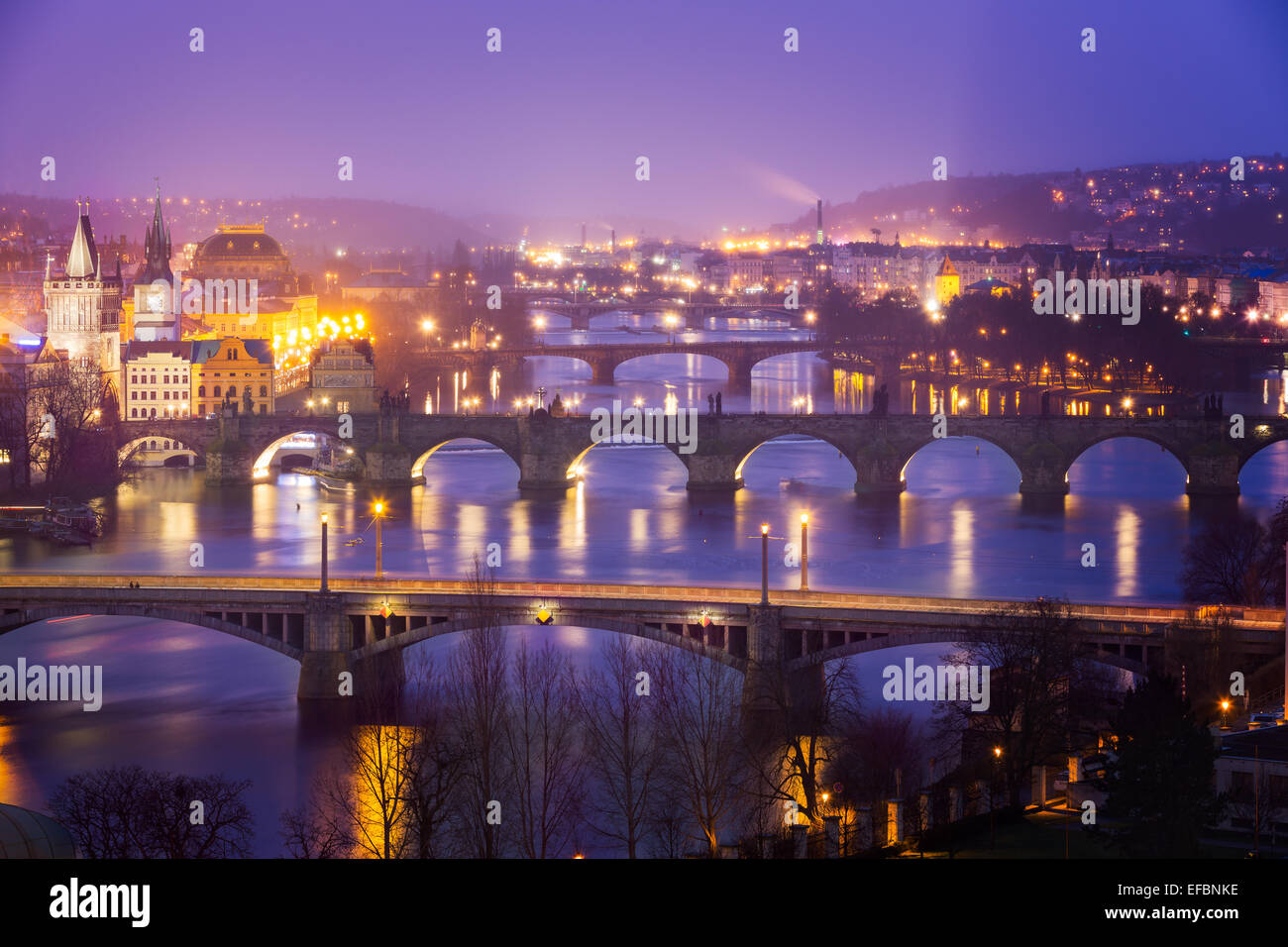 Vltava (Moldau) River at Prague with Charles Bridge at dusk, Czech Republic - Stock Image