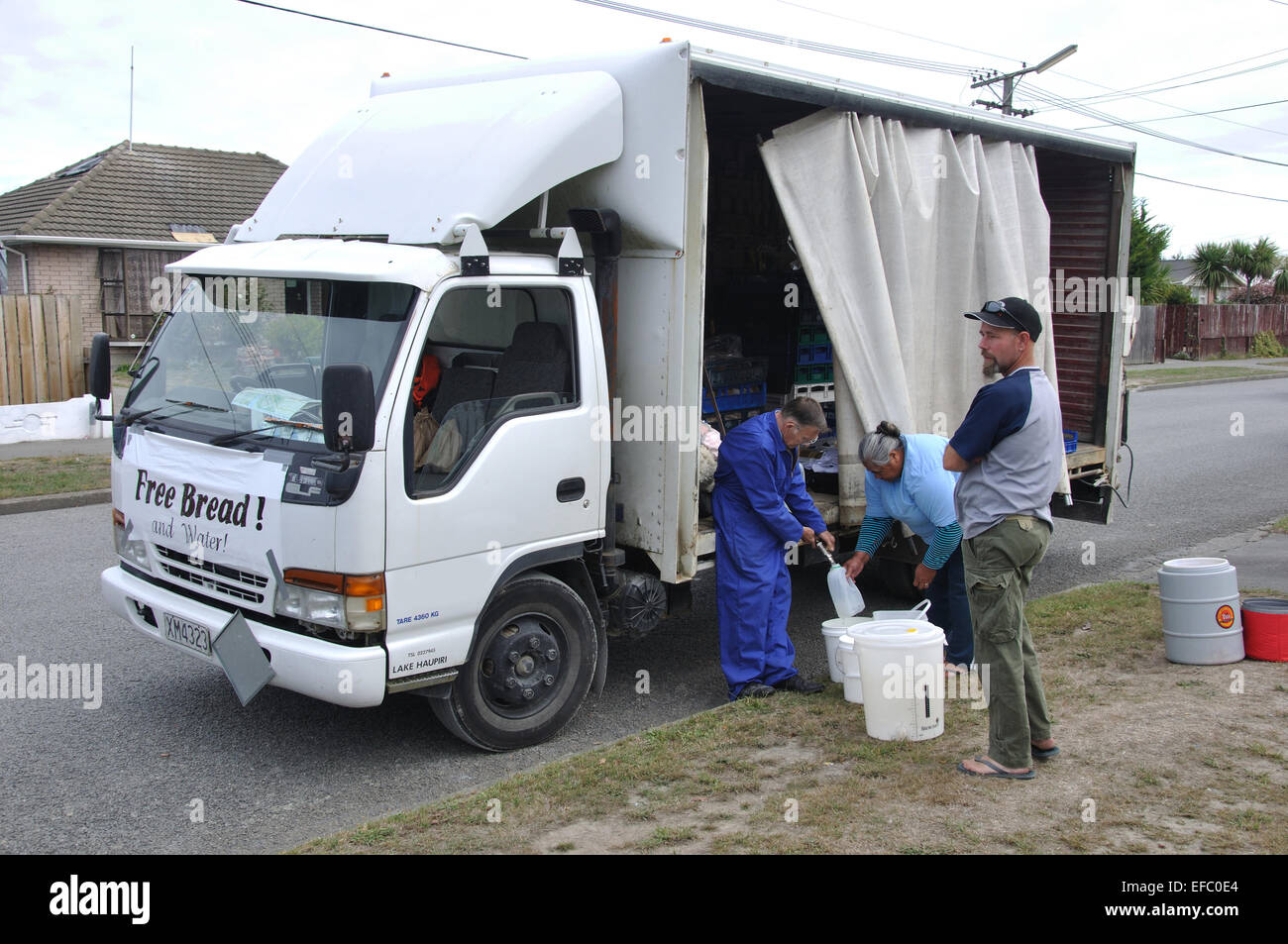 CHRISTCHURCH, NEW ZEALAND, FEBRUARY 22, 2011:  Volunteers bring water to the suburbs after the 6.4 magnitude earthquake - Stock Image