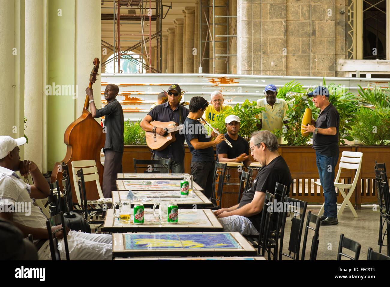 Cuba Havana Centro Habana Central Park Paseo de Marti ( Prado ) Hotel Inglaterra Son band group on terrace bar cafeteria - Stock Image