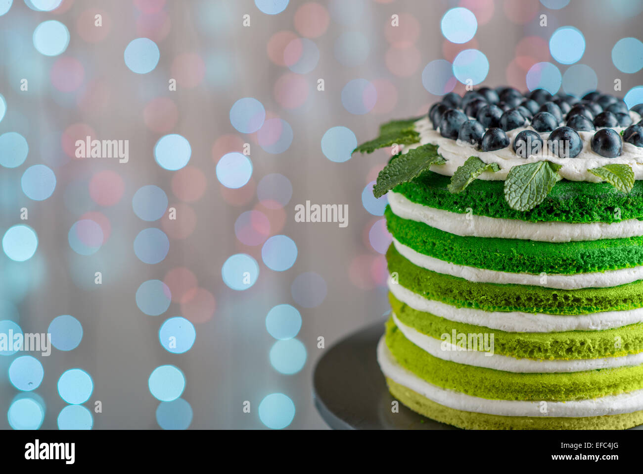 Nice Sponge Happy Birthday Cake With Mascarpone And Grapes On The Stand Festive Light Bokeh