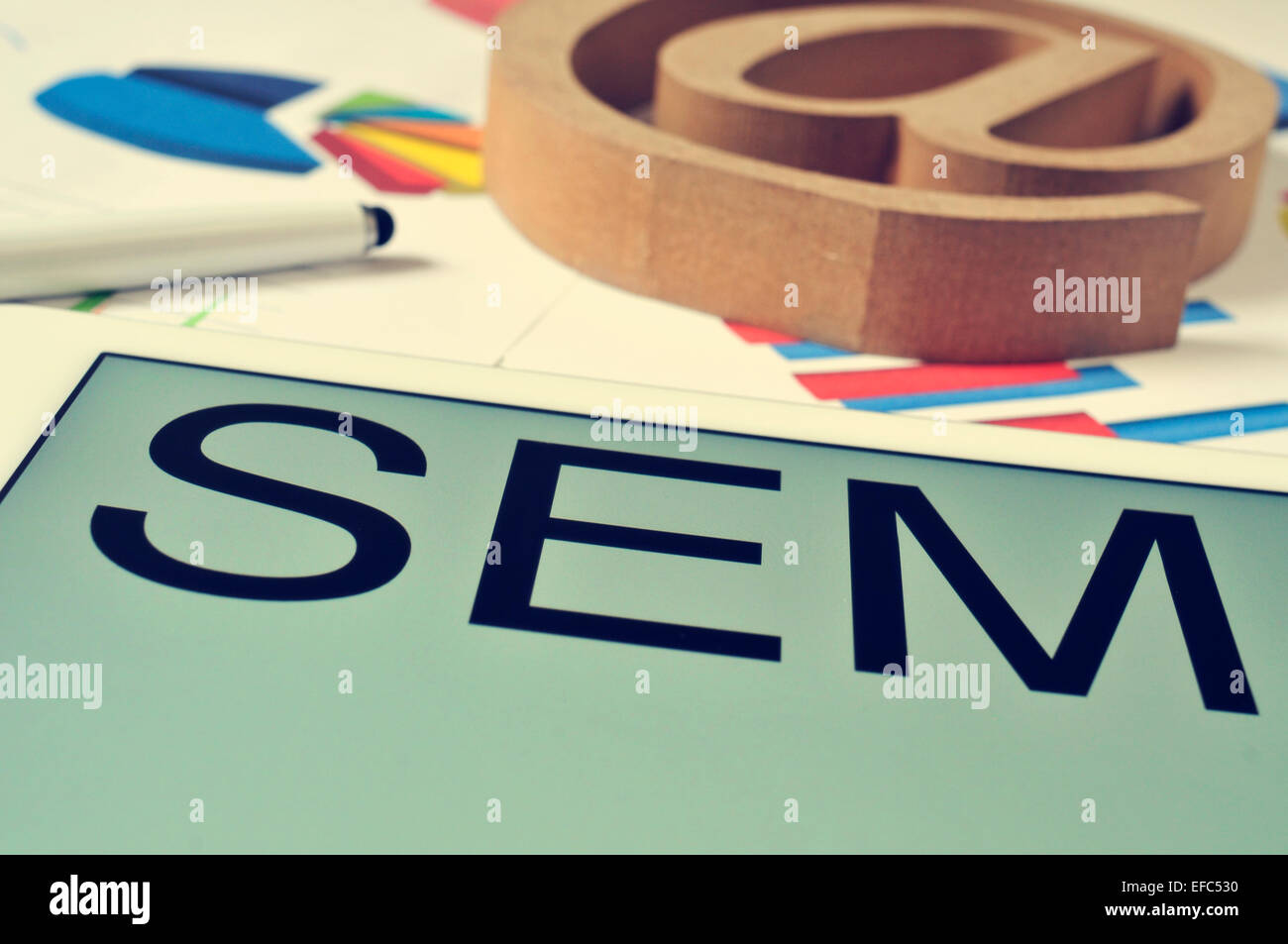 the text SEM, for Search Engine Marketing, in the screen of a tablet - Stock Image