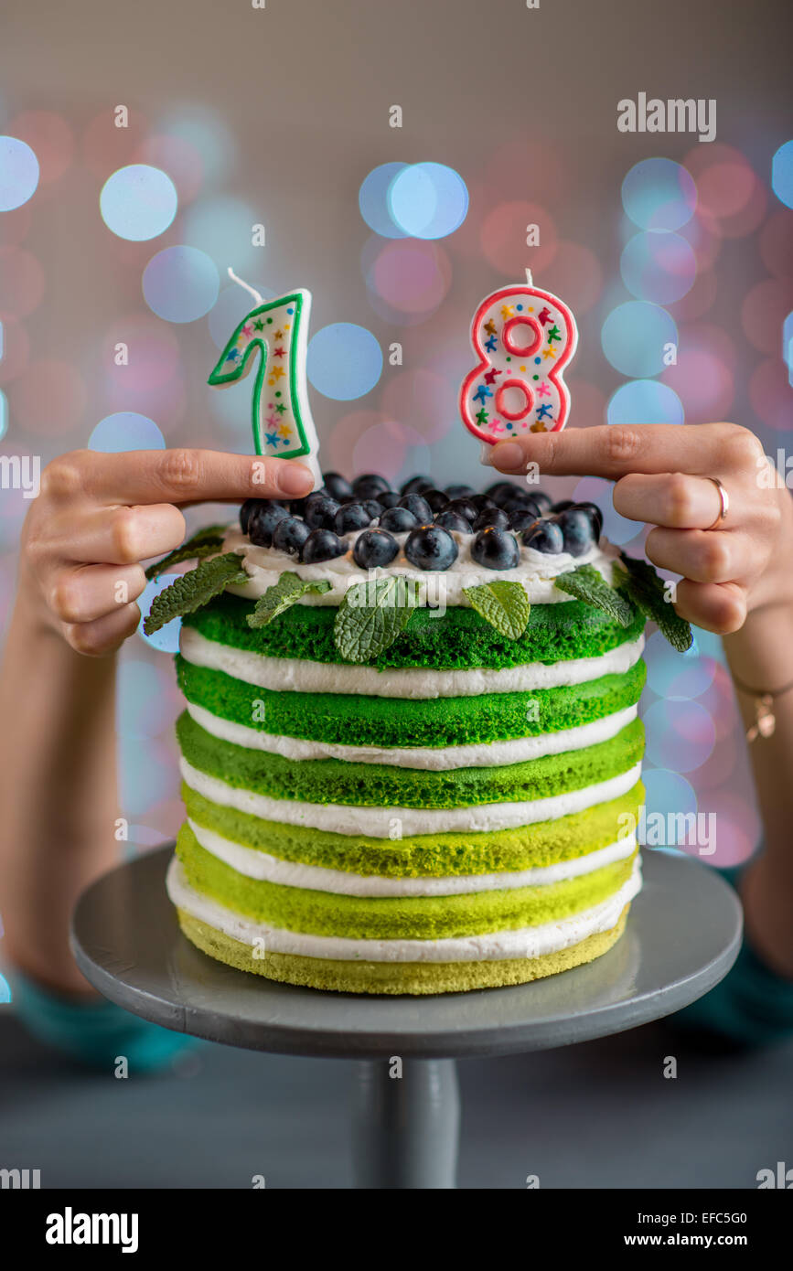 Nice Sponge Happy Birthday Cake With Mascarpone And Grapes On The Stand Candles Festive Light Bokeh