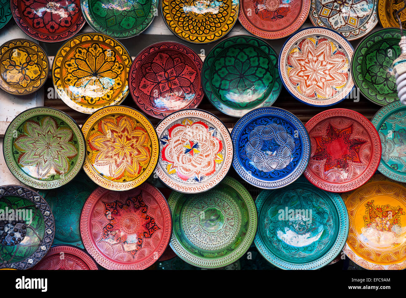 Ceramic plates on sale in a market, Marrakesh, Morocco - Stock Image