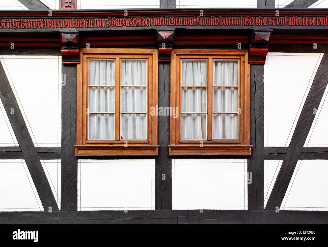 Windows of old timber framing house, Germany - Stock Image