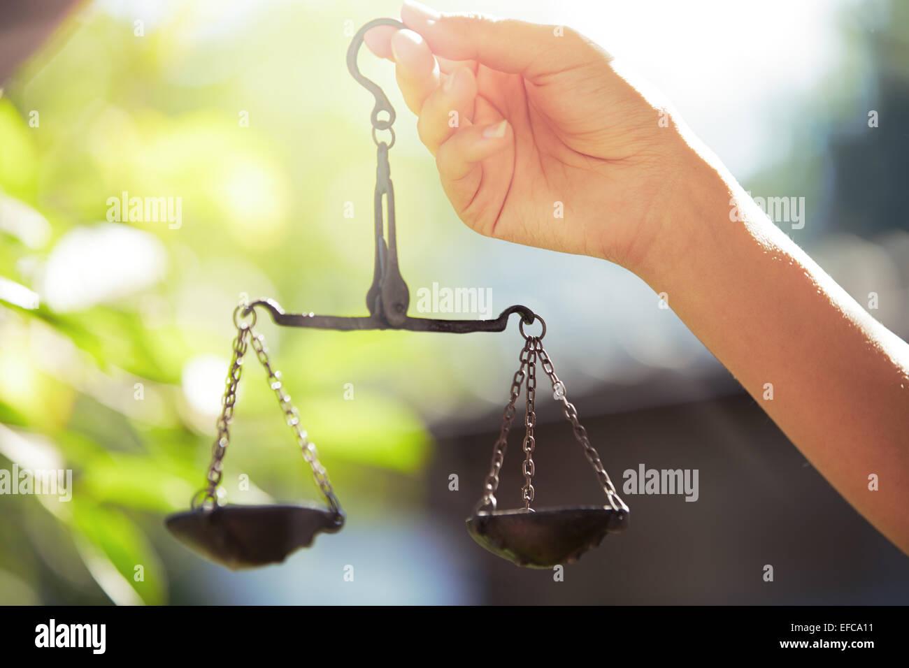 Woman hand holding scales. Horizontal photo - Stock Image