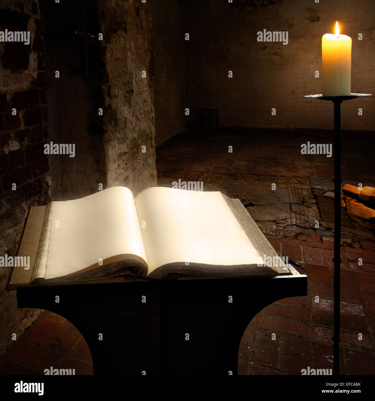 Open book with blank pages and candle - Stock Image