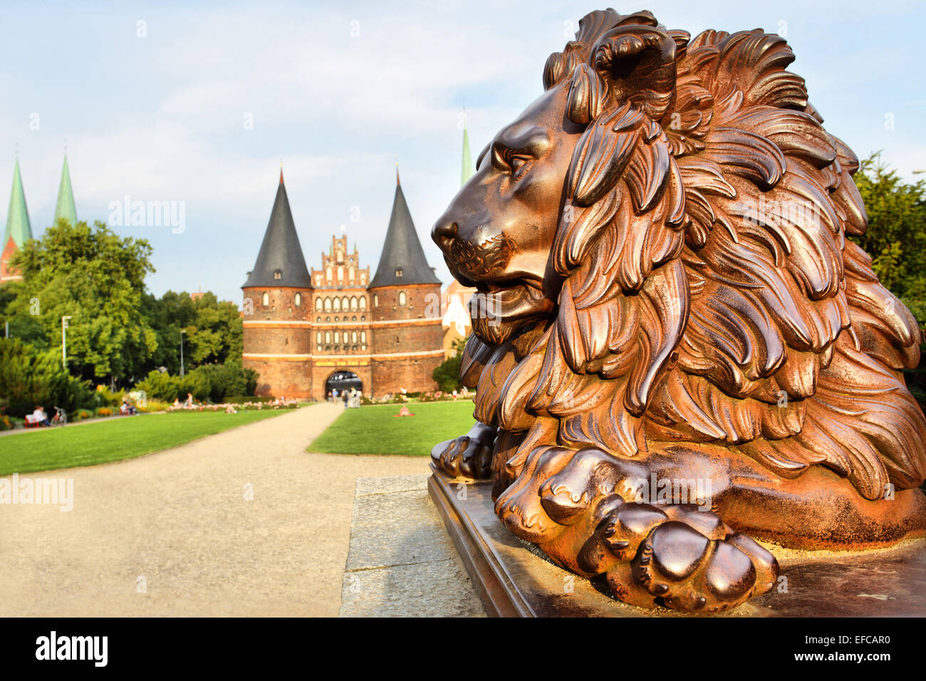 Lion beside Holstein Gate (built in 1478), Lubeck, Germany - Stock Image