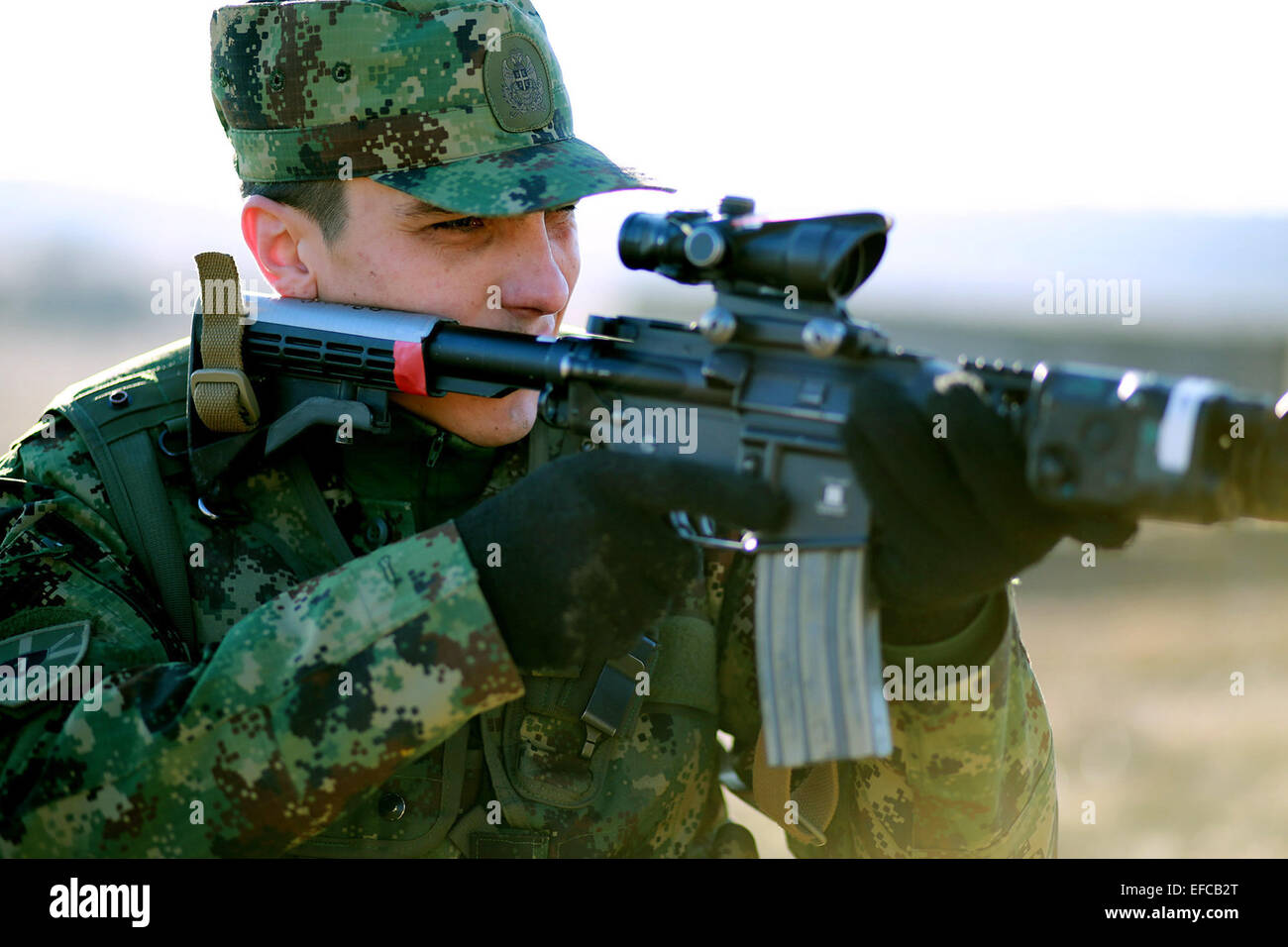 A sniper with the Serbian Army during joint training in the urbanized terrain course with the U.S. Marines January - Stock Image