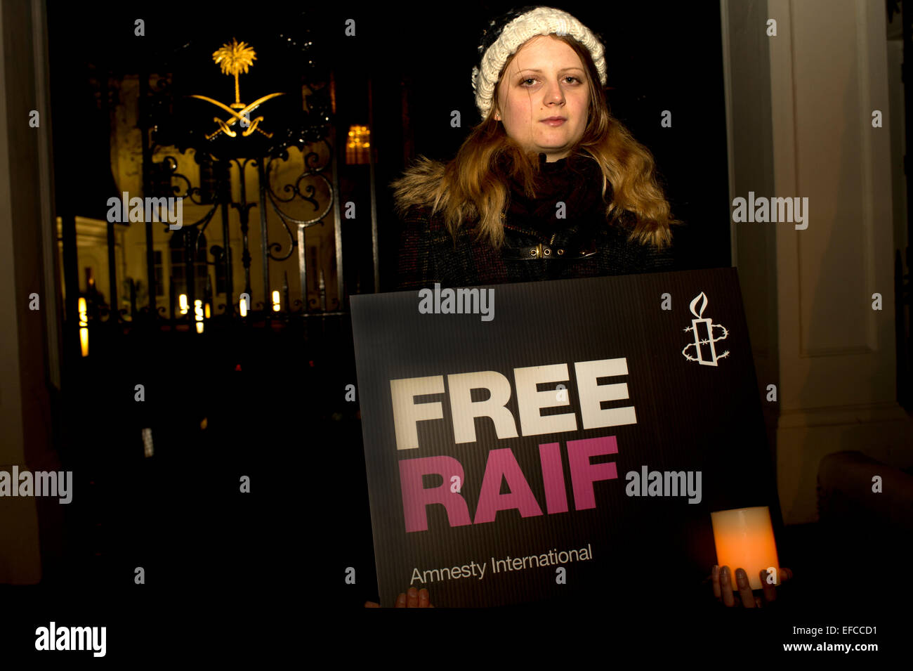 Protest outside the Embassy of Saudi Arabia, in London, organized by Amnesty International, against the flogging - Stock Image