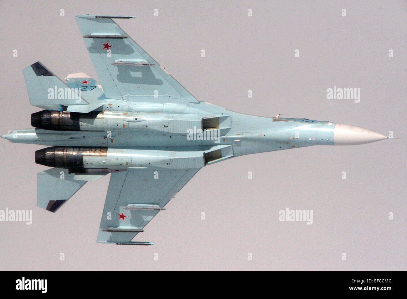 Russian Federation Air Force Su-27 Sukhoi fighter aircraft banks during an intercept of a simulated hijacked aircraft - Stock Image