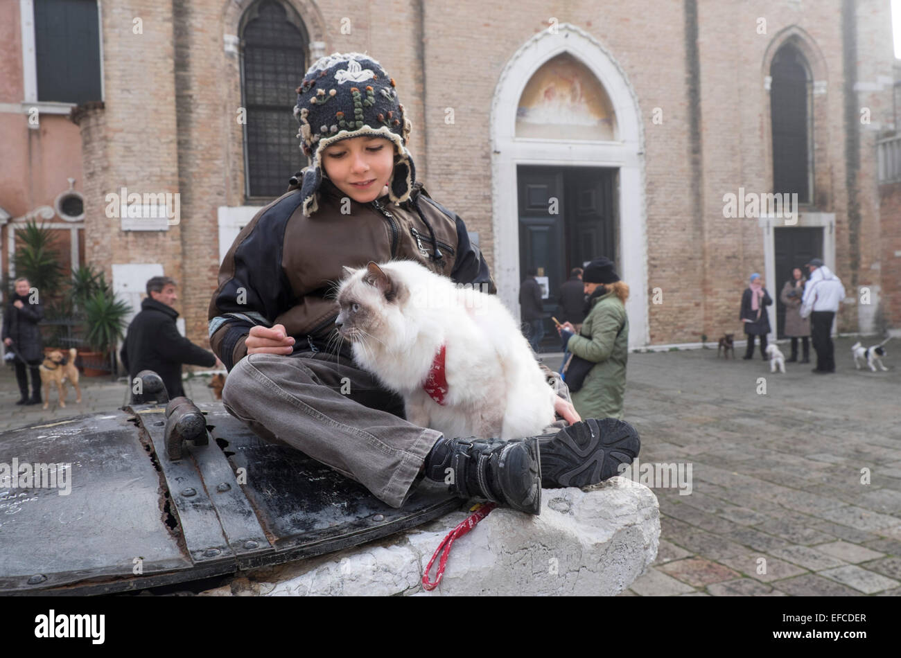 Owners with their pets  attend a special service  with a blessing animals, Church of S Giovanni Battista, Venice - Stock Image