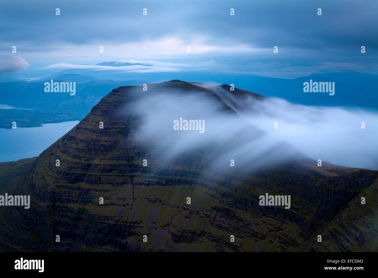 Here Tom na Gruagaich (Torridon) can be seen from Sgurr Mor during one of the few brief moments where visibility - Stock Image