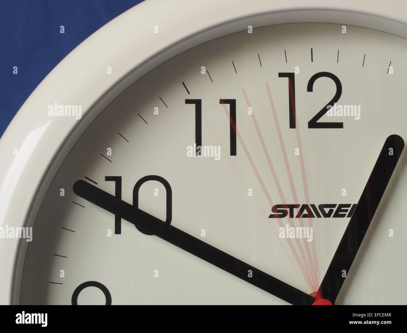 top left hand corner of a radio controlled wall clock showing movement of the second hand Stock Photo