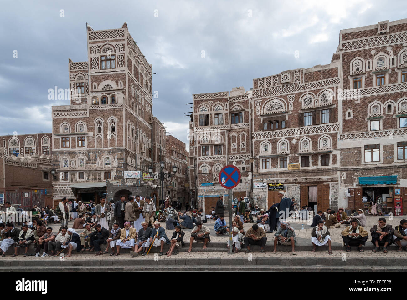 Unidentified men sit in the main square of the city on May 4, 2007 in Sanaa, Yemen. - Stock Image