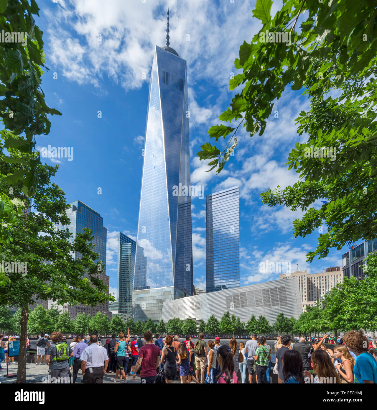 Visitors round the South Pool of the National September 11 Memorial with One World Trade Center behind, NYC, New - Stock Image