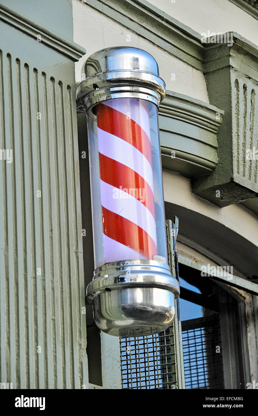 Red and white barber's pole. - Stock Image