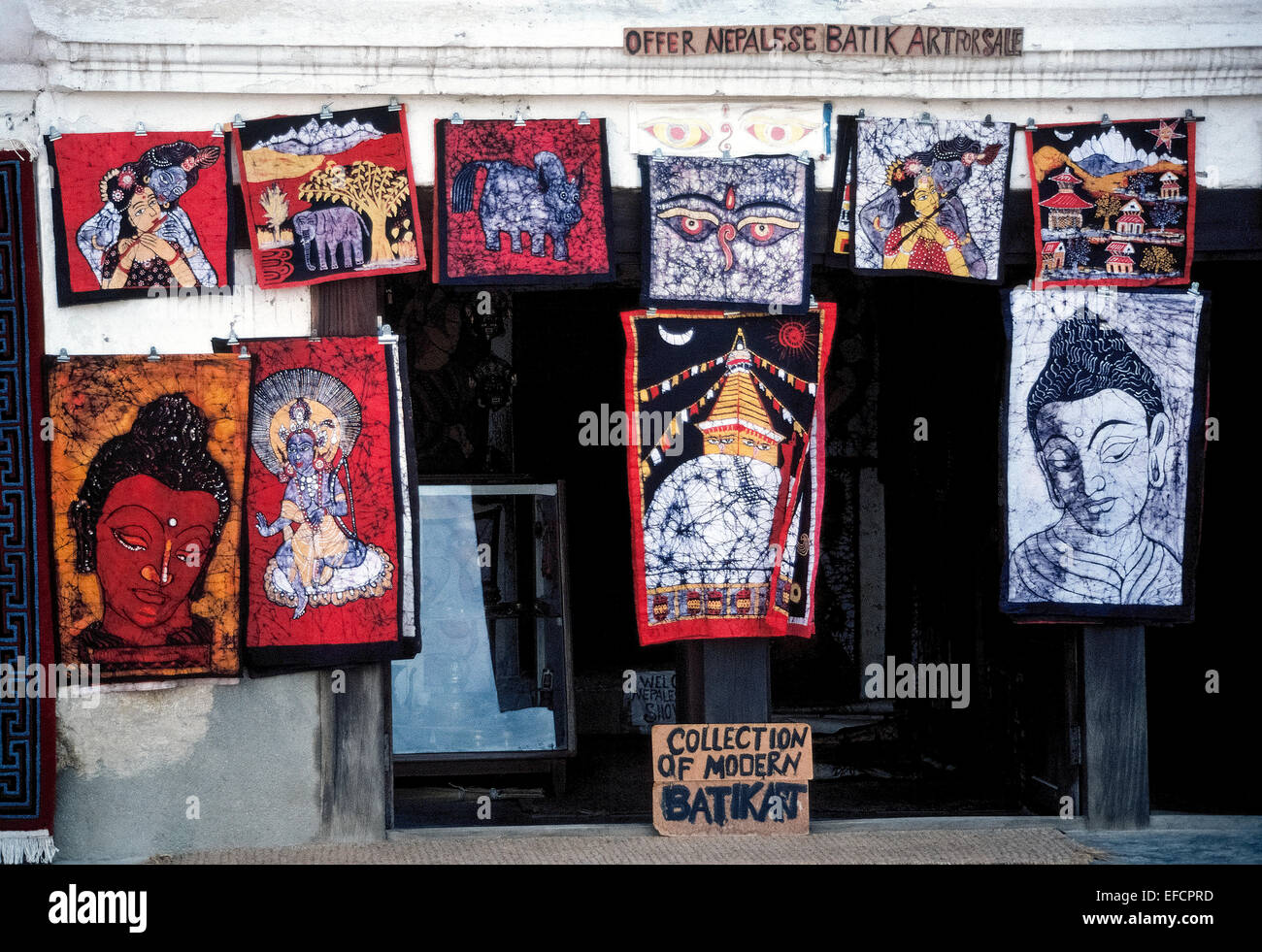 Handmade batik artworks with a variety of designs and colors are offered for sale outside of a shop in Kathmandu, - Stock Image