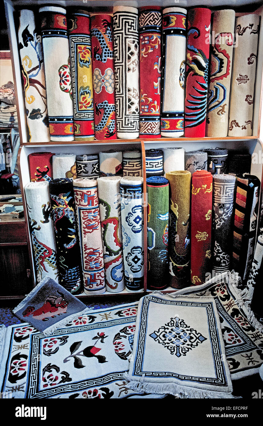 A wide selection of colorful handwoven Tibetan carpets are for sale in rug shops in Kathmandu, capital of Nepal - Stock Image
