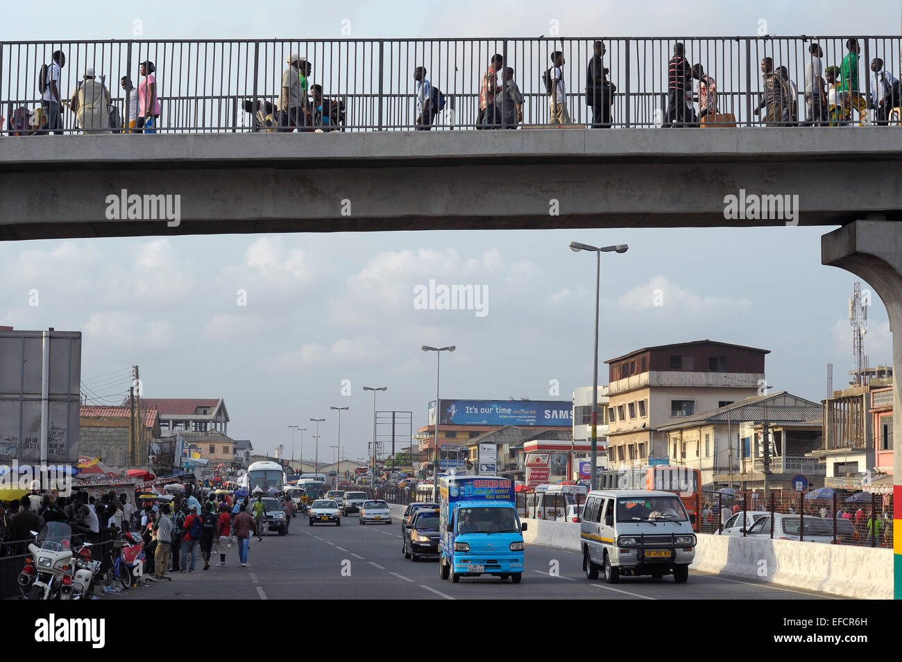 A pedestrian walkway over a main thoroughfare in downtown Accra, Ghana, West Africa. - Stock Image