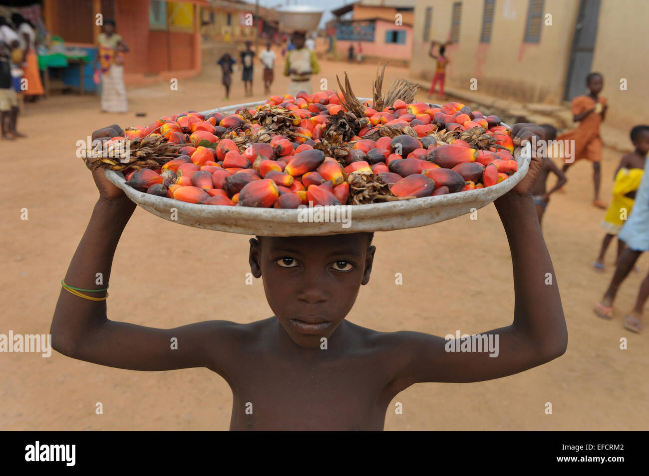 A boy selling produce on the street in Esiam, Ghana, West Africa. - Stock Image