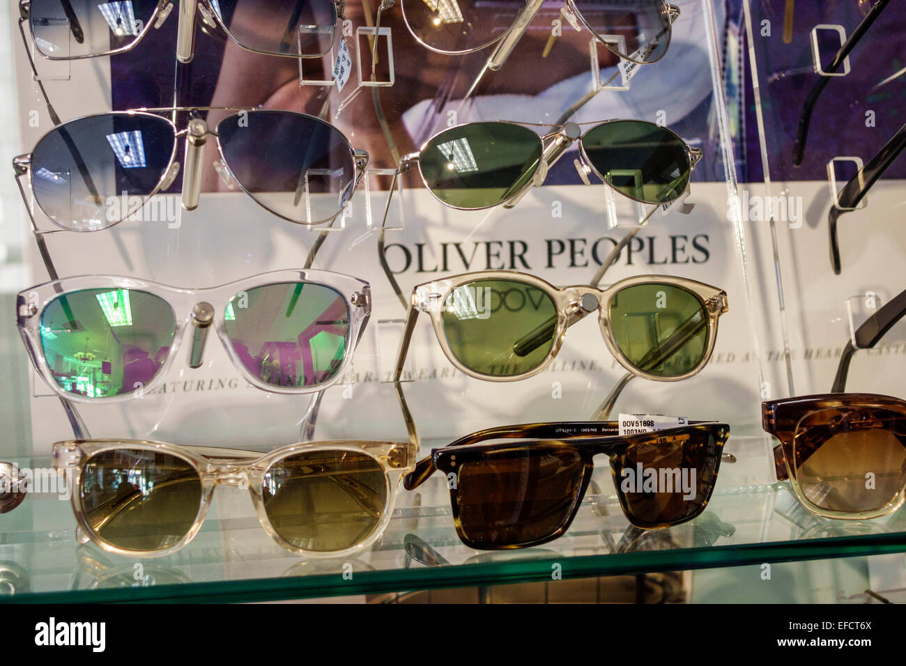 32da44b9c0 Miami Beach Florida man optician optometrist eyeglasses shopping sunglasses  Oliver Peoples