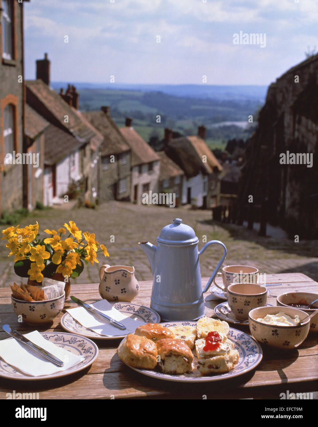 Afternoon cream tea on table at top of Gold Hill, Shaftesbury, Dorset, England, United Kingdom Stock Photo
