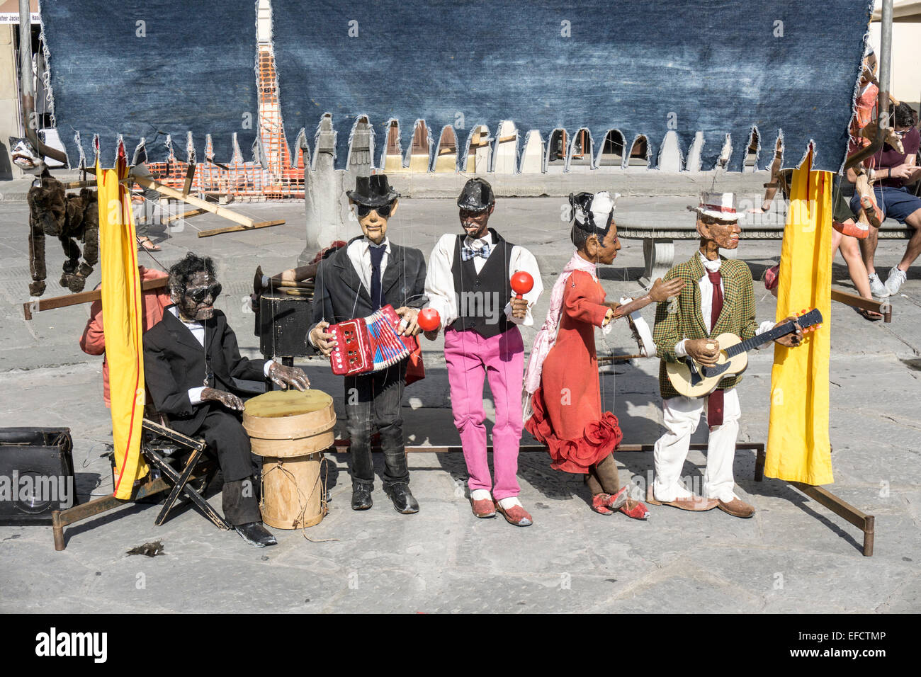 colorful old time blackface minstrel show with large worn lifelike puppets ready to perform in Piazza Santa Croce - Stock Image