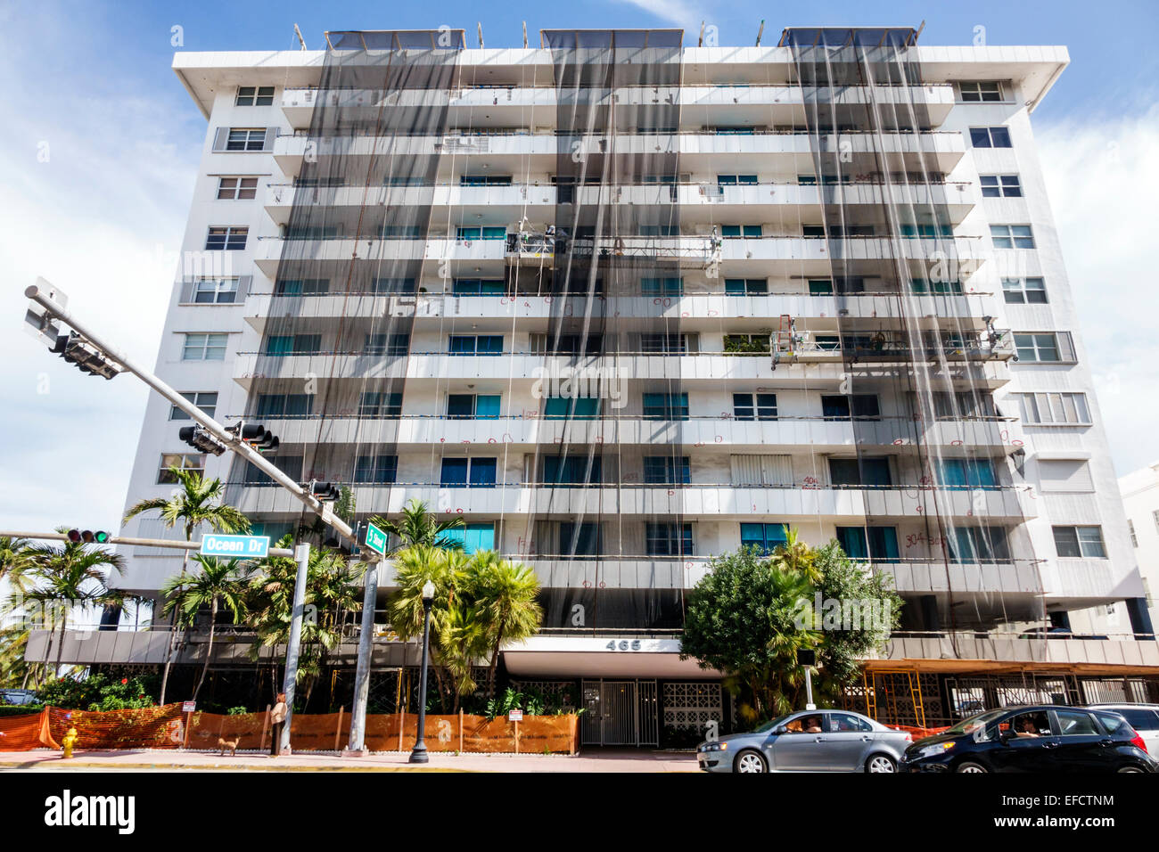 Miami Beach Florida Ocean Drive Royal Atlantic Condominiums undergoing renovation repair building debris screens - Stock Image