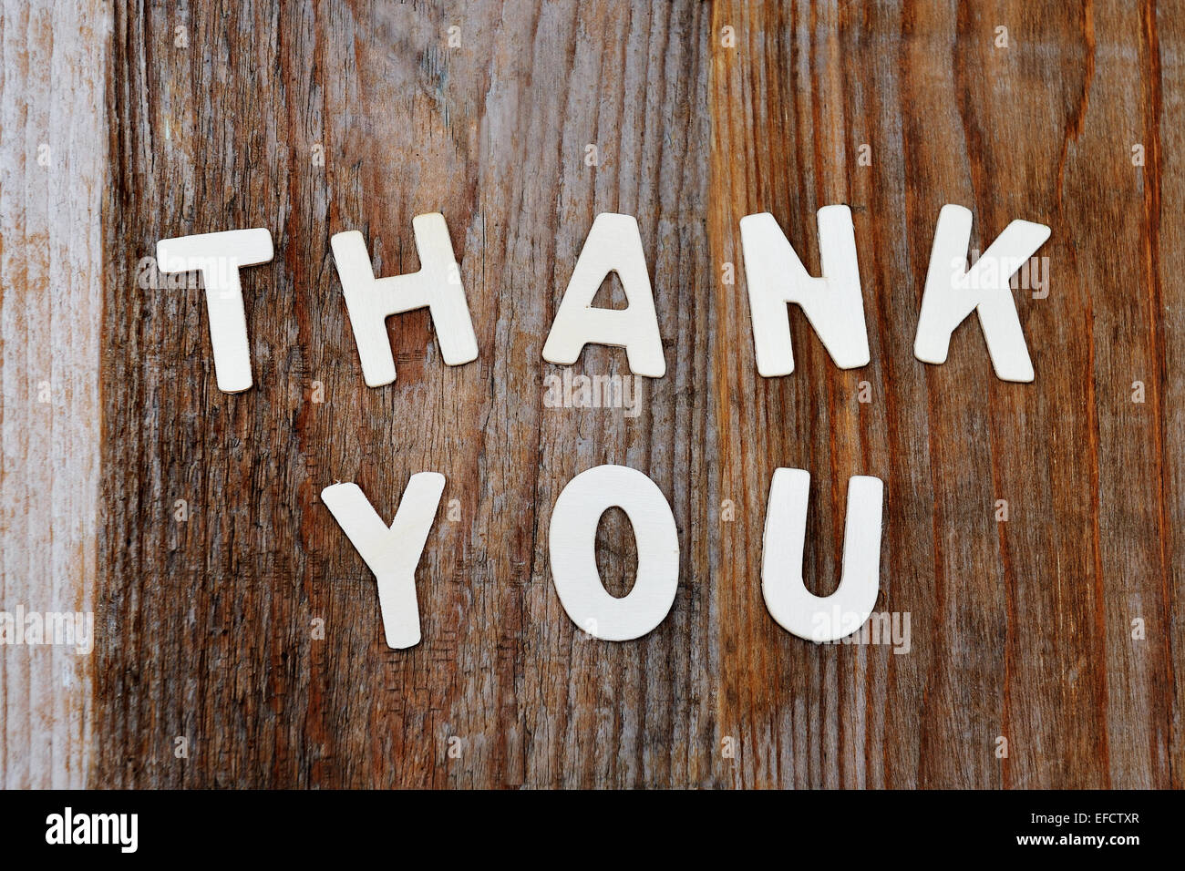 thank you words on brown wooden background - Stock Image