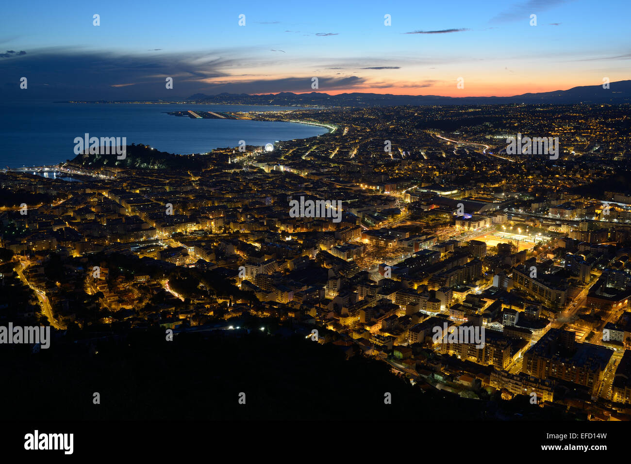 CITY OF NICE AT TWILIGHT Alpes-Maritimes, French Riviera, France. - Stock Image
