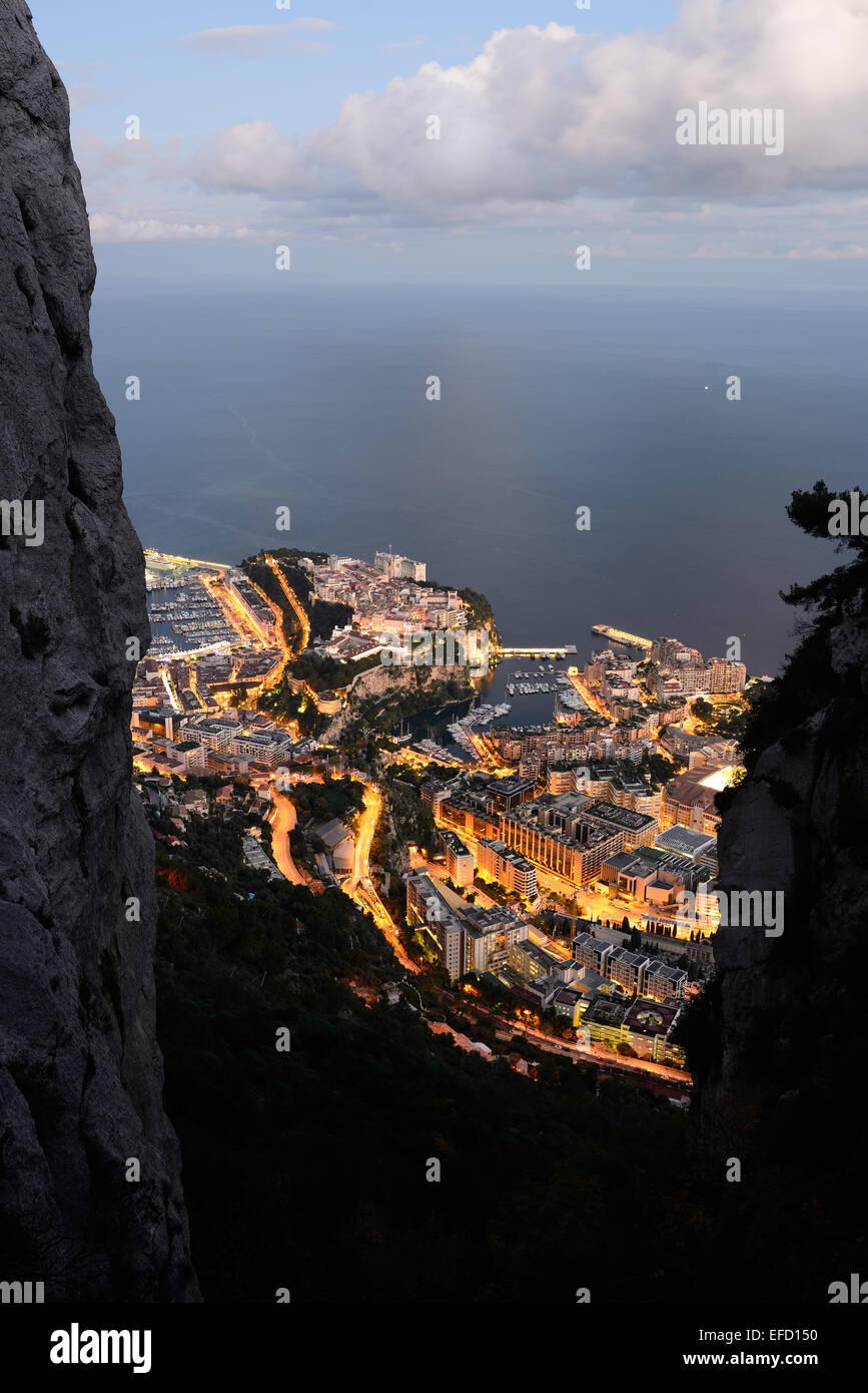 PRINCIPALITY OF MONACO AT TWILIGHT seen from an elevation of 550m amsl with two limestone cliffs to frame the famed - Stock Image