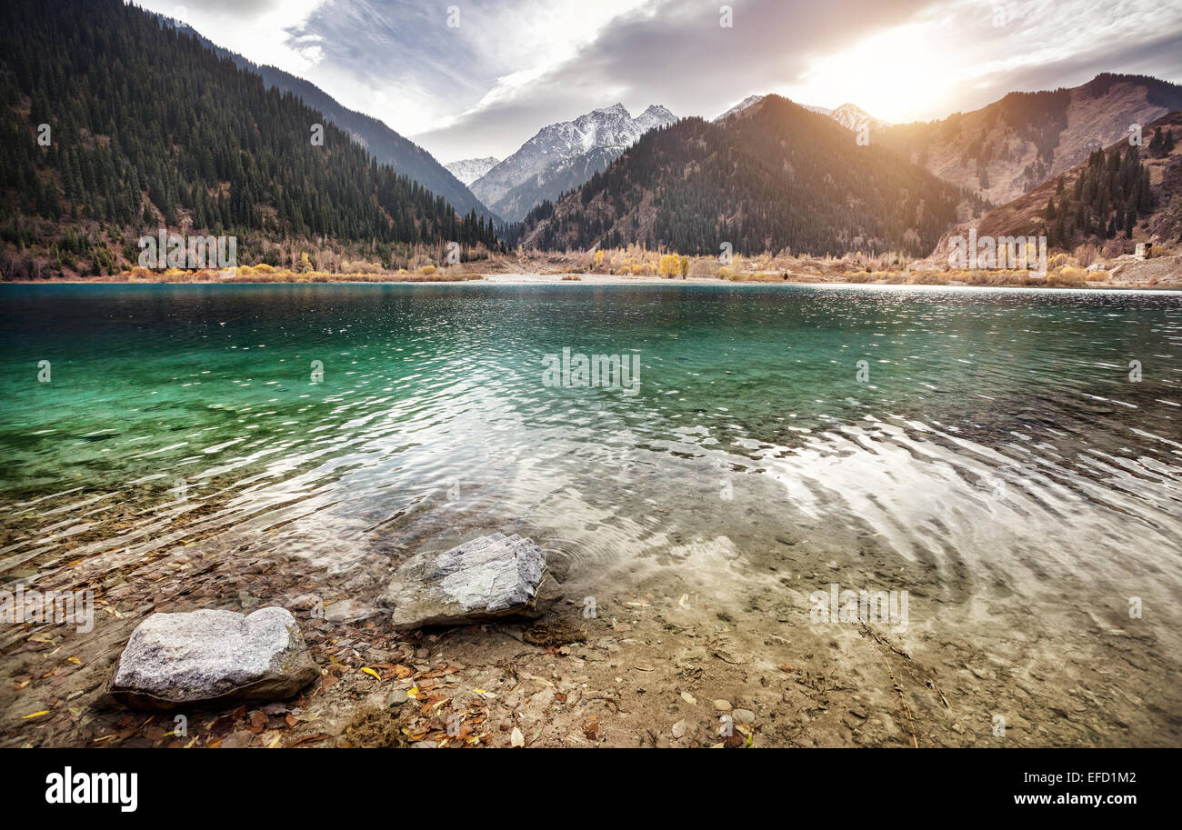 Issyk mountain lake at overcast sunset sky in Kazakhstan - Stock Image