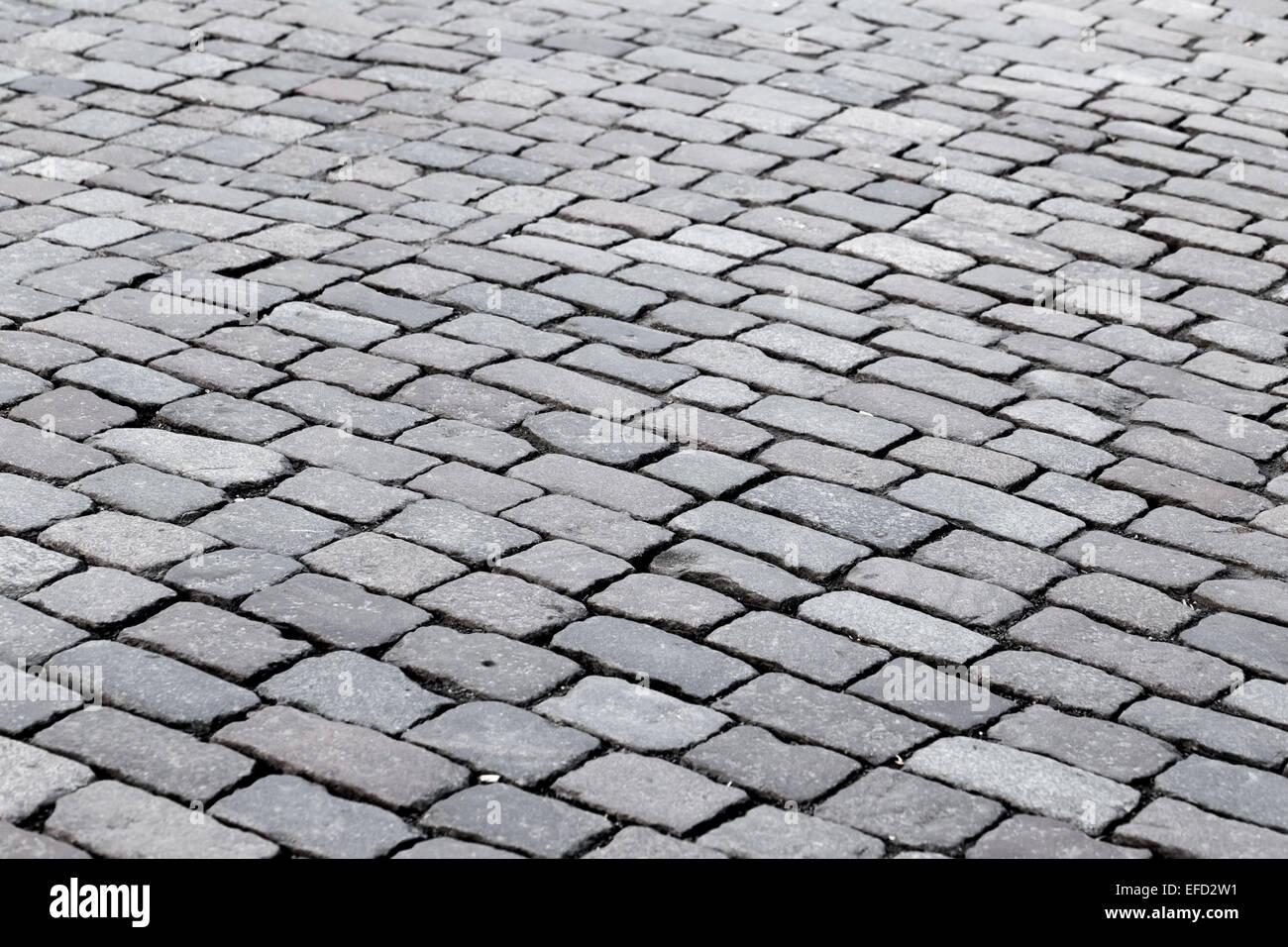 patterned paving tiles of olf sreet square - Stock Image