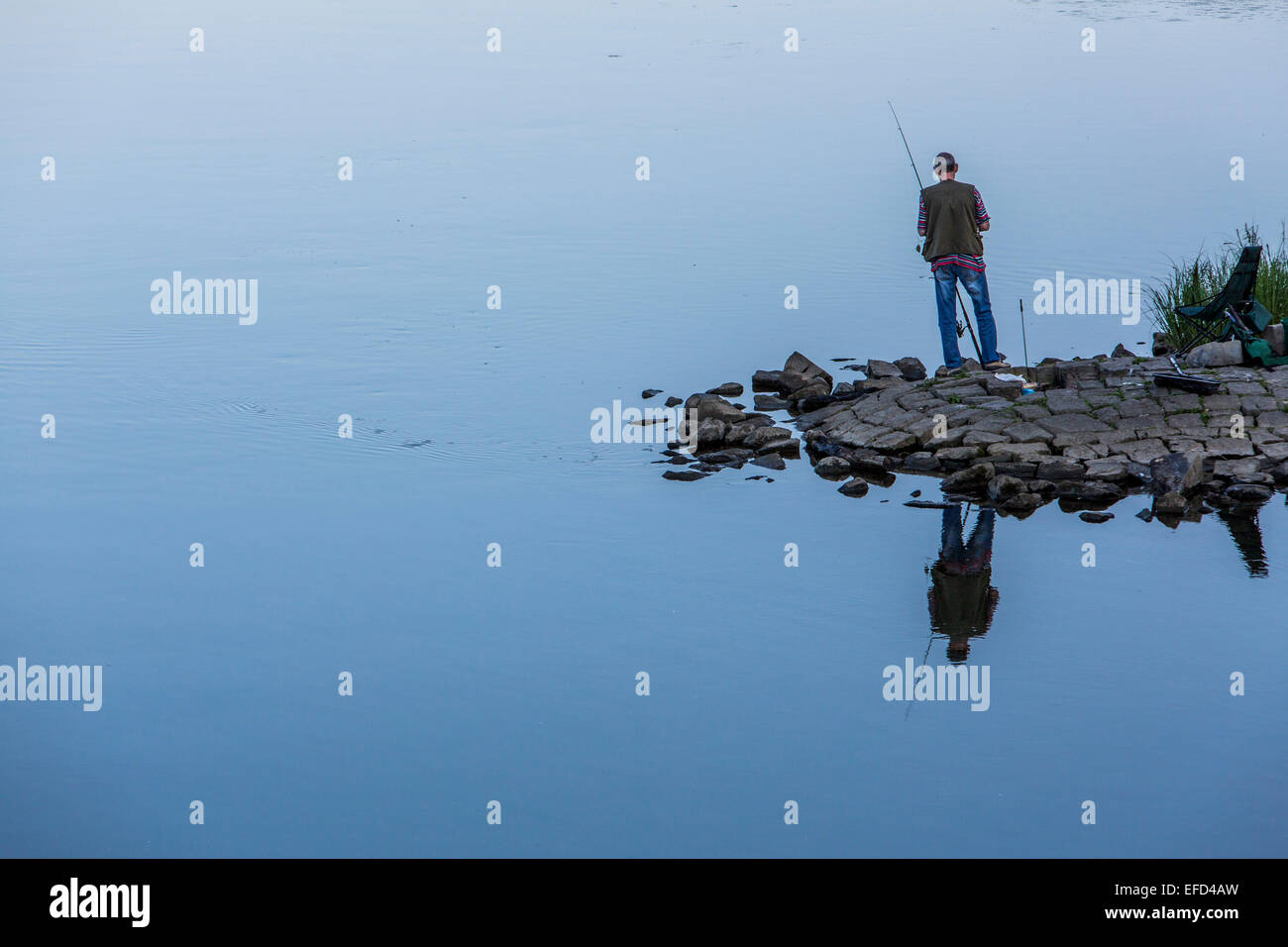 Angler fishing, river Ruhr, Essen, Germany - Stock Image