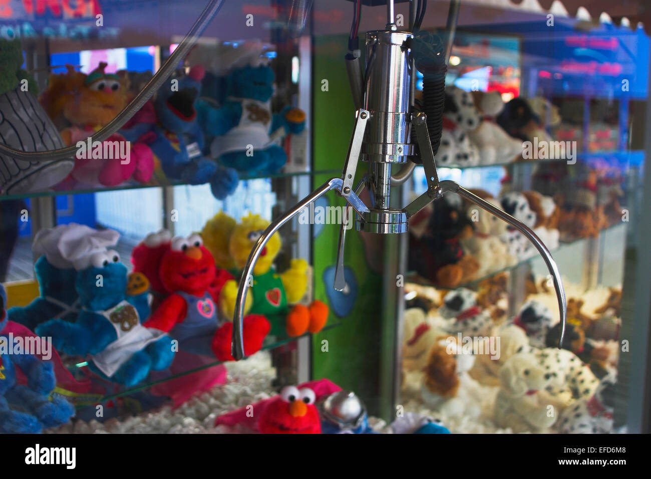 Claw Grabber fairground soft cuddly toy prize  Brighton Pier, Sussex - Stock Image