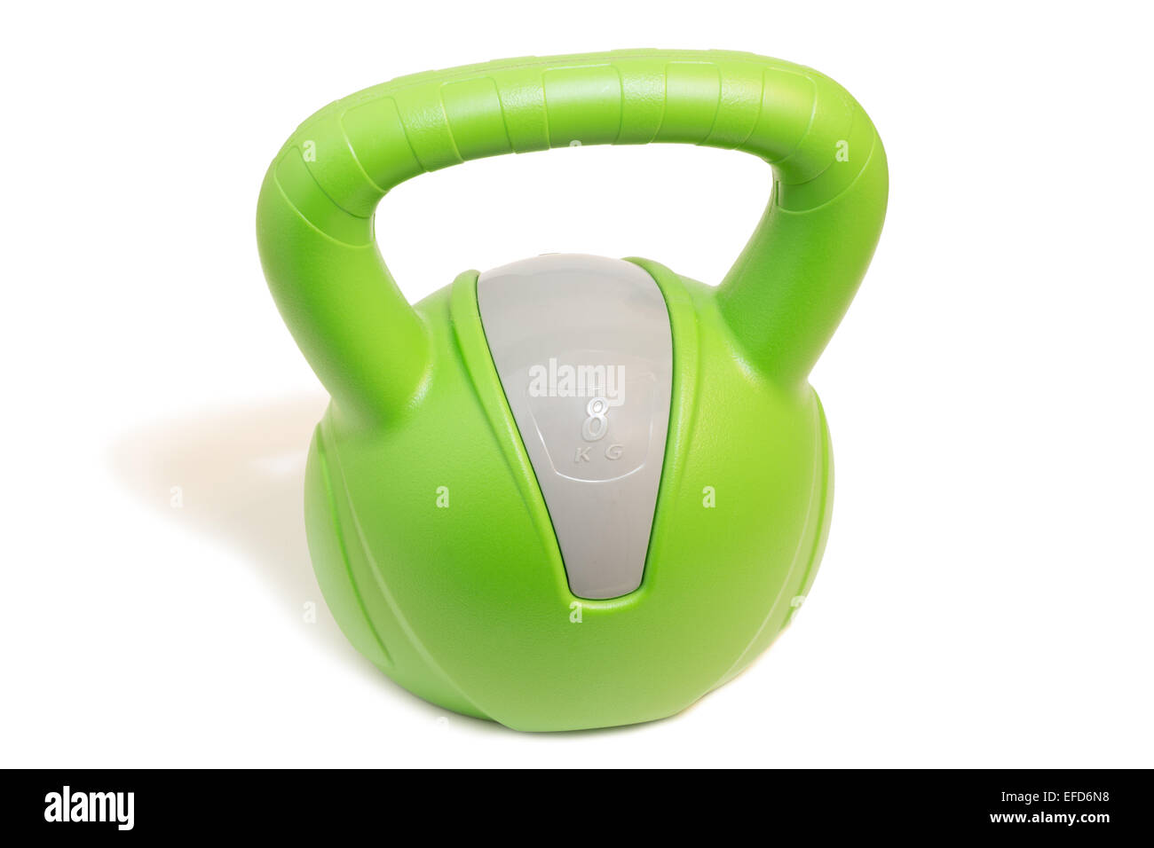 Closeup of a green 8 kg kettlebell, isolated on white background - Stock Image