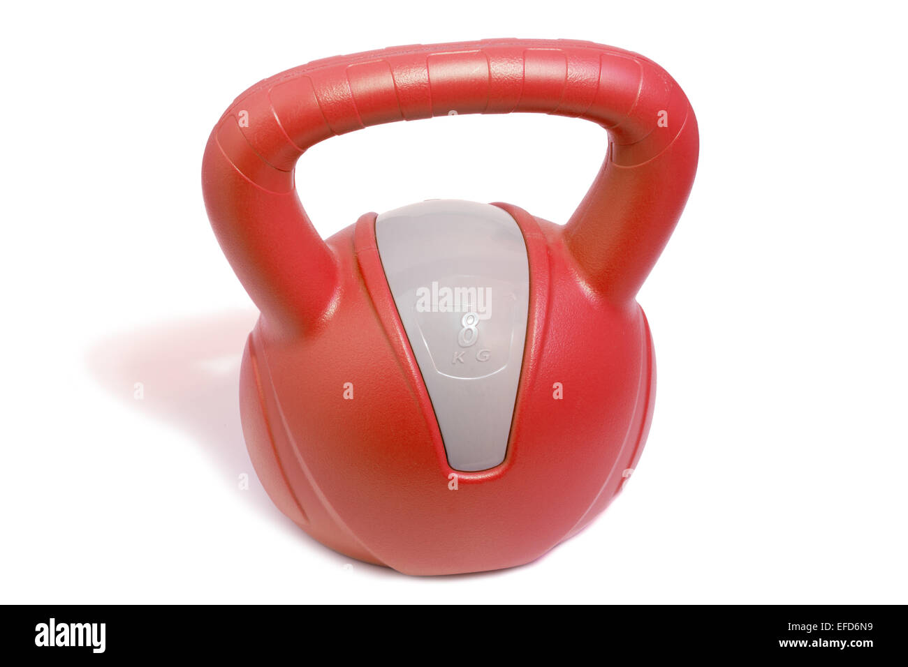 Closeup of a red 8 kg kettlebell, isolated on white background - Stock Image