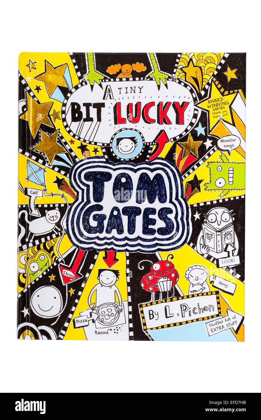 The Tom Gates book A Tiny bit lucky on a white background - Stock Image