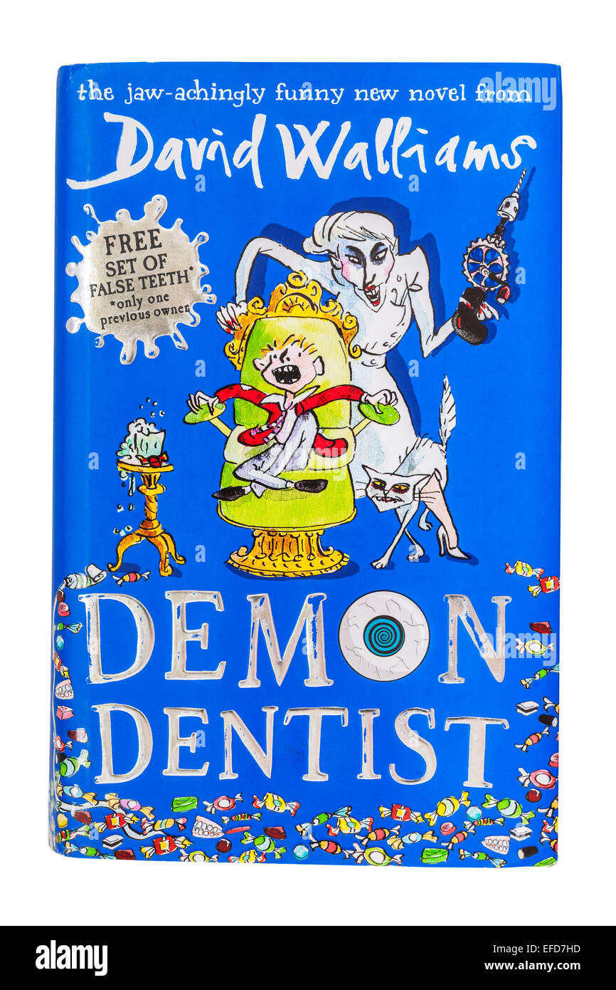 The book called Demon Dentist written by David Walliams on a white background - Stock Image