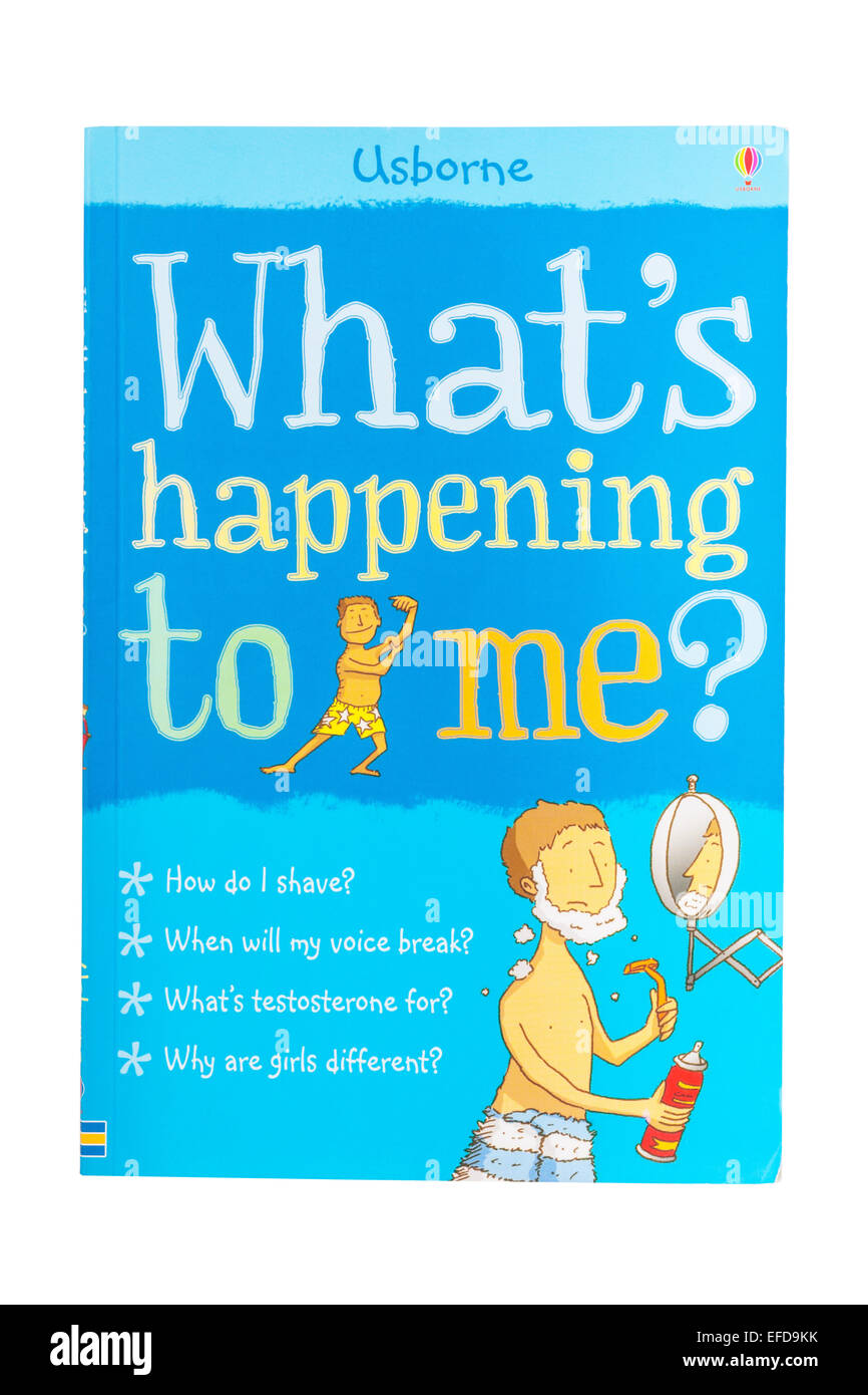 The Usborne What's happening to me book on a white background - Stock Image