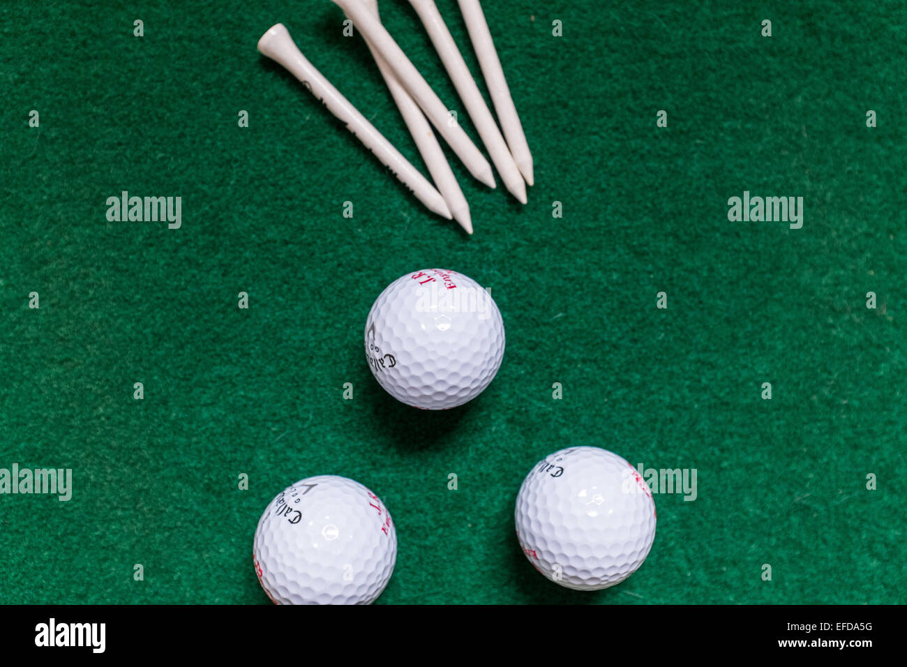Golf balls and tees - Stock Image