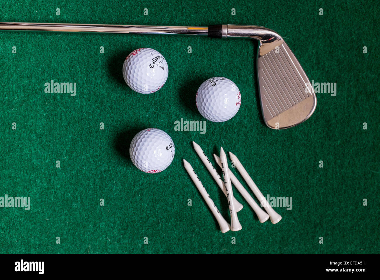 Golf club with tees and balls - Stock Image