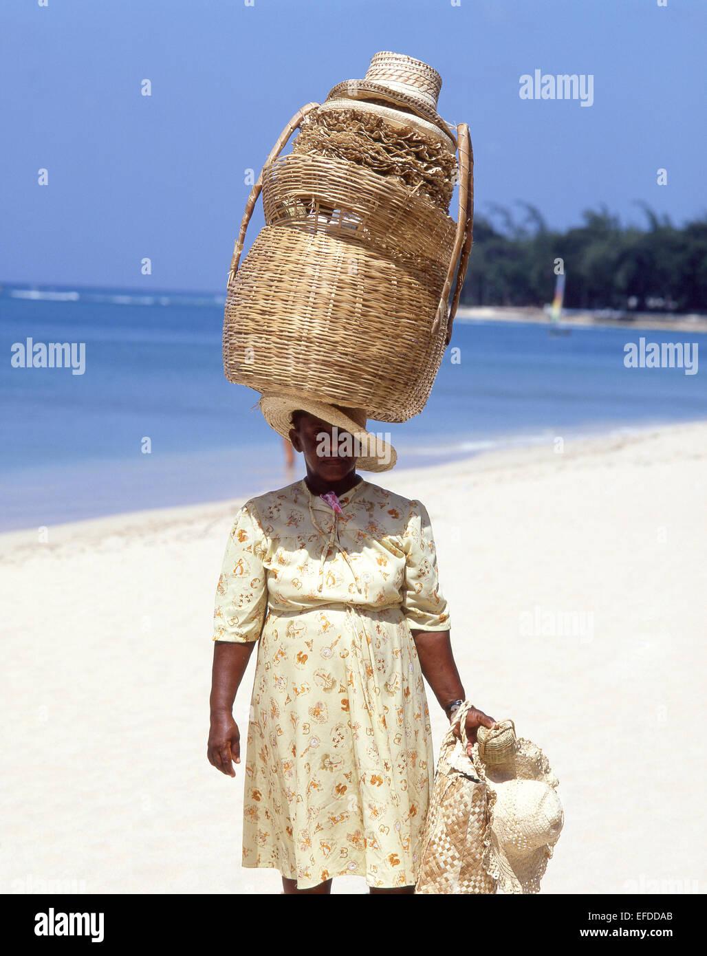 Woman basket seller on beach, Sandy Lane Beach, Saint James Parish, Barbados, Lesser Antilles, Caribbean - Stock Image