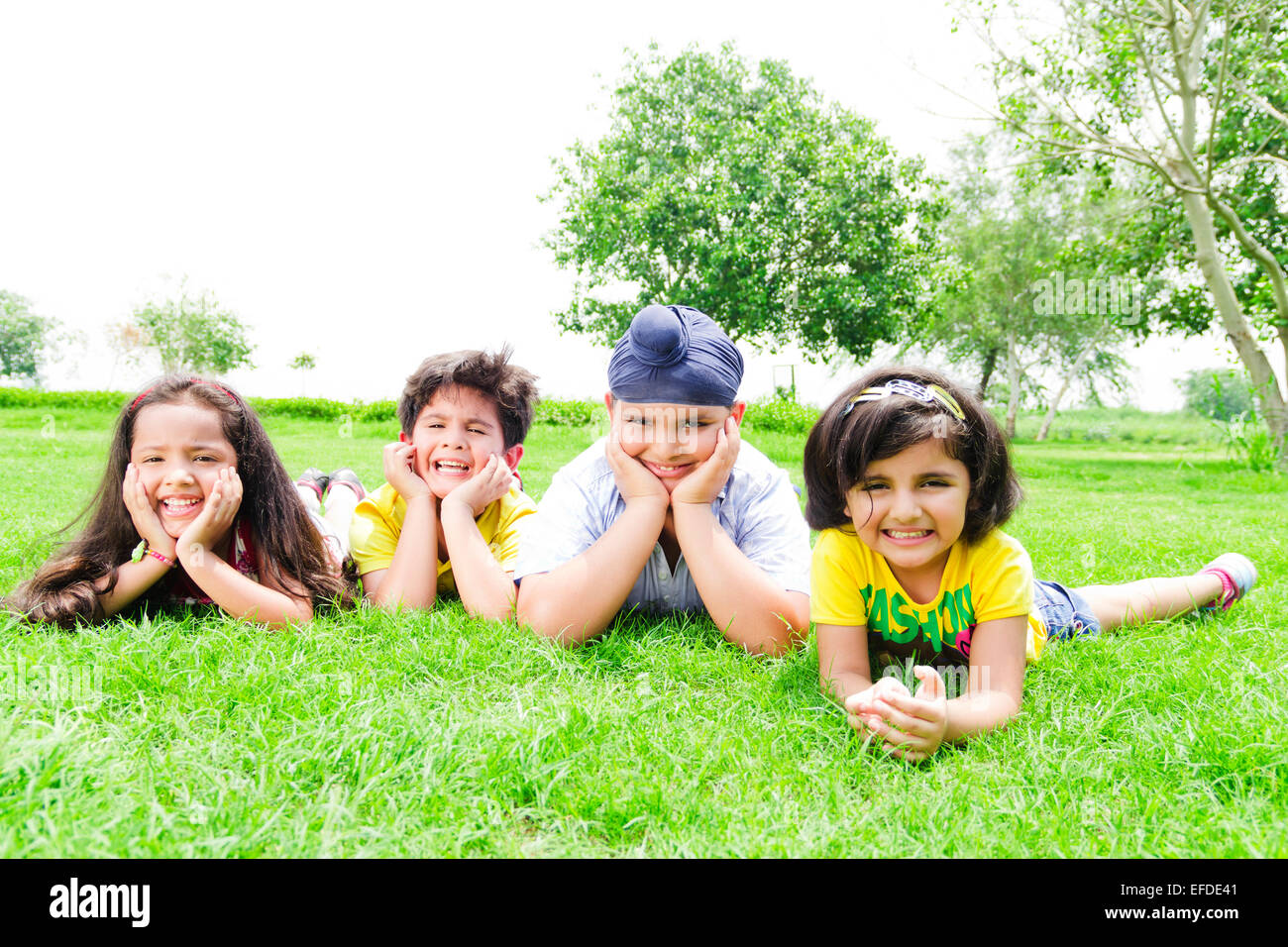 4 indian children friends park enjoy Stock Photo