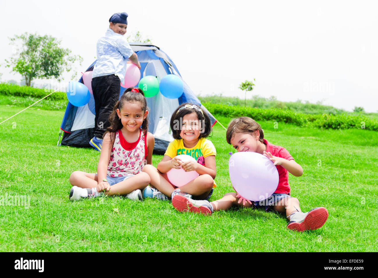 e3c69f30b64d 4 indian children friends Picnic park fun Stock Photo  78357813 - Alamy